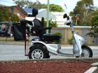 A motorized scooter at the Shell servo on Minjungbal drive Tweed Heads.