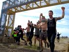 Competitors tackle the 2013 Tough Mudder event on the Sunshine Coast. Crossing the finish line. Photo: Warren Lynam / Sunshine Coast Daily
