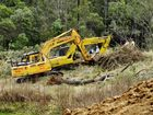AN EXCAVATOR operator's leg was crushed by a tree as he worked on a dam wall at a rural property west of Ipswich.