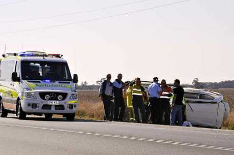 Emergency services at the scene of a fatal traffic crash 10km east of Dalby on the Warrego Hwy.