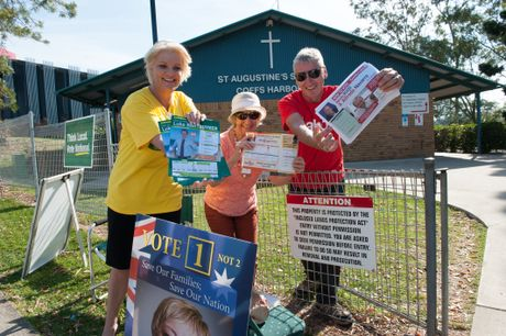 Election helpers Karen Luke, Maureen Nichols and Trevor Honeysett display democratic goodwill outside the St Augustine's polling booth.