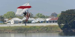Pilot Anton King is towed behind a boat driven by Paul Ramsom in a flight to celebrate 50 years since hang gliding took place on the Clarence River.