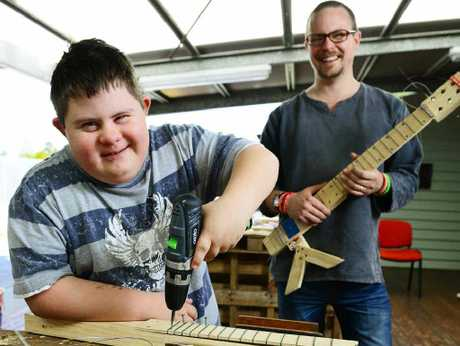GUITAR HERO: Jarred Owers (left) learns how to build his own electric guitar when Nye Stewart from JAM visits Luke's Place.