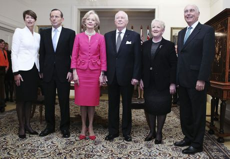 New Australian Prime Minister Tony Abbott (2nd L), his wife Margie (L), Governor-General Quentin Bryce (3rd L), her husband Michael Bryce (3rd R), leader of the National Party Warren Truss (R) and his wife Lyn (2nd R) pose for photographers after Tony Abbott was sworn in as the 28th prime minister of Australia during a ceremony in Canberra on September 18, 2013.