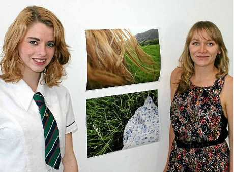 DISCOVERING BEAUTY: Keely Colliton from Blue Hills College and Lismore TAFE teacher Bettina Walton with Keely's photographs from the Wonder exhibition at Lismore TAFE.