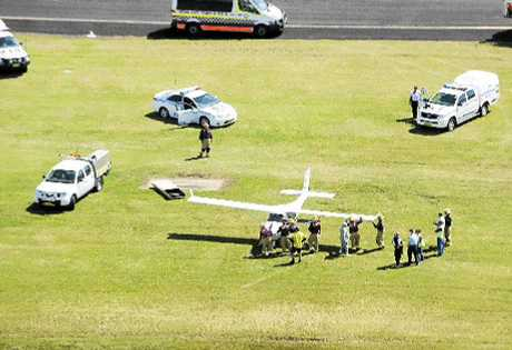 LUCKY ESCAPE: Emergency services attend the scene of a light aircraft mishap on the main runway at Ballina Airport yesterday morning.