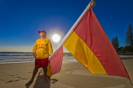Vice president of Yamba Surf Club Andrew Morris gets the flags ready for ptrol season starting this weekend on Yamba Main Beach. Photo Adam Hourigan / The Daily Examiner
