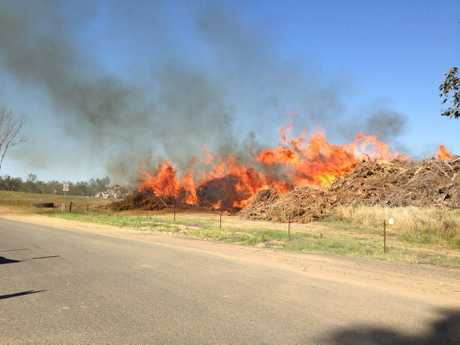 TIP FIRE: The blaze burning earlier today at the Nanango dump.