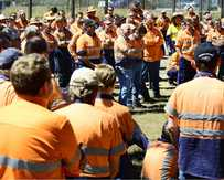 ANGER: Aurizon rail workers hold a meeting with union officials yesterday after 85 redundancies were announced in Ipswich.