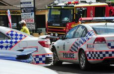 CAR CRASH: Emergency services attend the scene of a crash on Walker Street.