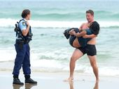 TWEED Police Senior Constable Mathew Huckle swam at least 250m out to sea to save an injured woman this month.