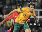 BACK ON THE WINNERS' LIST: The Socceroos' Mile Jedinak gives a Canadian defender the slip on Wednesday.