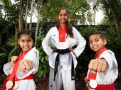 Tyla Gunning, 8, Mia Gunning, 14 and Austin Gunning, 8 all came away from the National Taekwondo Festival with medals. Photo Inga Williams / The Reporter