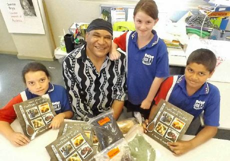COOKING LESSONS: Indigenous chef Mark Olive with Casino Public School students Maddison Smith, Madison Parker and Kirhys Walker.