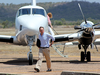 Federal Environment Minister Greg Hunt as he arrives in Bowen yesterday afternoon.