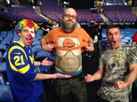 Justin Deming poses at a recent WWE RAW taping with fellow superfans 'Frank the Clown' and 'Brock Lesnar Guy'