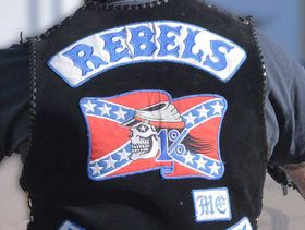 """<strong>UPDATE:</strong> A furious Rebels bikie gang member says he and his sons face six months in jail for the """"crime"""" of having a beer together at a Sunshine Coast hotel."""