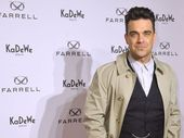 "ROBBIE Williams was ""terrified"" of becoming a father."
