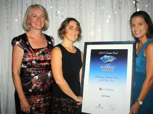 Leeza Boyce, left, of Sunshine Coast TAFE presents Elizabeth Salisbury and Lindsay Planck the Outstanding Business Person of the Year Award on behalf of Ian Pratt from Lexis English Group at the 2013 Sunshine Coast Business Awards, Palmer Resort Yaroomba Photo: Erle Levey / Sunshine Coast Daily