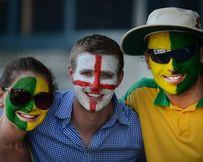 Fans of both the Australian and English cricket teams pose for a photo during day 1 of the first Ashes Test at the Gabba in Brisbane, Thursday.