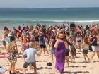 SCHOOLIES celebrating on the Sunshine Coast have been caught flashing unsuspecting crowds at Noosa - but they didn't seem to mind.