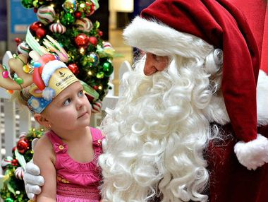 Three-year-old Taya Greaves puts in her order with Santa.