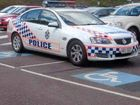 POLICE have defended their use of disabled parking bays at a Sunshine Coast high school after photos posted on the internet sent social media into a spin.
