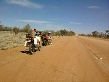 Friends ride trail bikes from Mackay to the Simpson Desert.