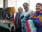 Cr Rose Swadling, Major Colin Maxwell from the Salvation Army and Lesley Guy from Australian Red Cross with items generously donated from the Lively Knitting and Crocheting Club.