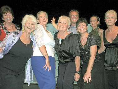 FUN TIMES: Coolum Theatre Players old and new ham it up on stage at the group's 25th anniversary celebrations.