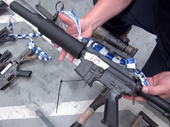 POLICE have uncovered one of the largest holdings of illegal firearms, military style weapons and ammunition in Queensland after searching a Monto property.