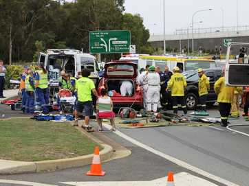 Scenes from a crash at Banora Point where a man was trapped in his car about 4pm, Friday November 11, 2013.