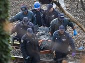 A COMMUTER train veered off the tracks in Manhattan,  killing at least four people and injuring more than sixty others including its driver.