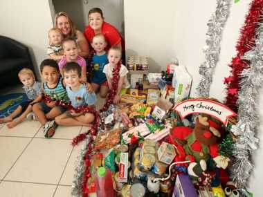 The Children of Excellence in Care have been collecting items for Food Bank. Photo Inga Williams / The Satellite