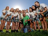 Tweed River High's champion girls touch football team with coach Chris Swaddle.