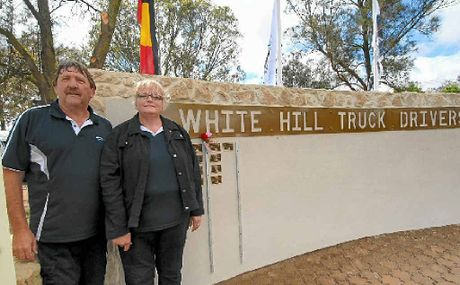 """PAYING RESPECTS: The man behind the White Hill Truck Drivers Memorial and his wife, Keith """"Woody"""" Wood and Cathie Wood."""