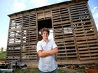Angus Hughes is constructing a building out of used pallets and other recycled materials. Photo Allan Reinikka / The Morning Bulletin