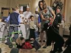 IT was all fun and Christmas merriment when US First Lady Michelle Obama met military personnel and their children at The White House - at first.