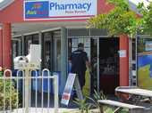 Police at the scene of a robbery at the pharmacy on Murphy St, Point Vernon.