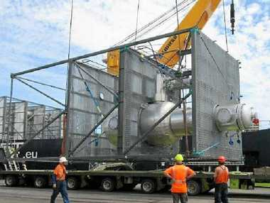 GREEN COUP: Modules being lifted onto the ship in New Zealand for the new Northern Oil Refinery being built by Southern Oil.