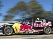 CHARGING BULL: Jamie Whincup (inset, left, with Craig Lowndes) drives his Red Bull Racing Australia Holden during practice at Homebush yesterday.