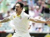 ON A ROLL: Australia's Mitchell Johnson celebrates after knocking over the leg stump of Stuart Broad, the Englishman going for a golden duck.