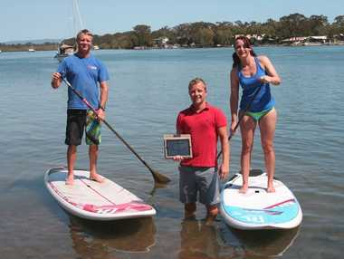 Bookme Australia owner Greg Miller with new clients Rachel Ratajczak and George Tarr from Adventure Sports Noosa.