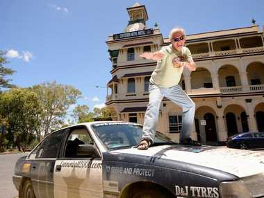 Brendan Edgerton with his commodore he has driven around the world. Photo Allan Reinikka / The Morning Bulletin