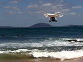 Eye in the sky: quadcopter capturing footage of surfers at Point Cartwright, Sunshine Coast.