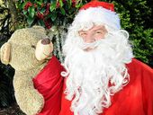 HAPPY DAYS: It's going to be a busy time for Santa and his representatives, like Benny Muldoon, of Lismore, this year.