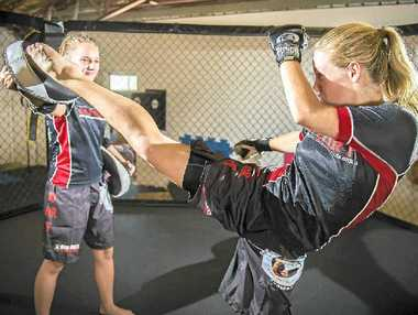 DETERMINED YOUTH: Mixed martial arts students Sharna Mercer and Kaela Banney practice their discipline at the Gladstone Martial Arts Academy.