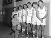 A READER who has been involved with basketball for 61 years says this photograph is of the first Rockhampton team to compete in a Queensland championship.