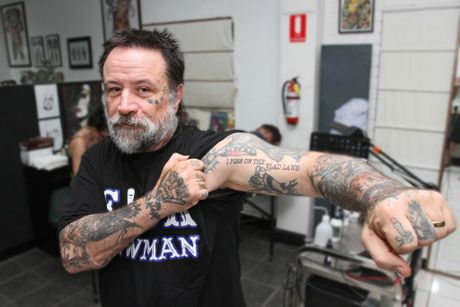 "Angelo Garozzo of Caloundra Tattoo Studios is offering free ""I PISS ON THE VLAD LAWS!"" tattoos. Photo Darryn Smith / Sunshine Coast Daily"