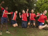 From left, Liam Sauney, Claude Sypher, Jason Barnes, Kenzo Chooi and Emma Harvey jump for joy at finishing Year 7 at Rangeville State School.